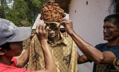 creepy-indonesian-festival-sees-the-dead-dug-up-and-dressed-and-paraded-in-streets.jpg