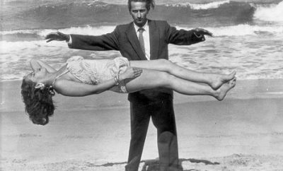PKT3315 - 235467  1965  Indian magician Yusultini and his wife Faeeza demonstrate their 'levitation' act on a beach near Durban, South Africa.....which seems to disprove the popular theory it's done with wires hanging from the stage roof.